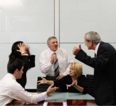 Business men and women arguing